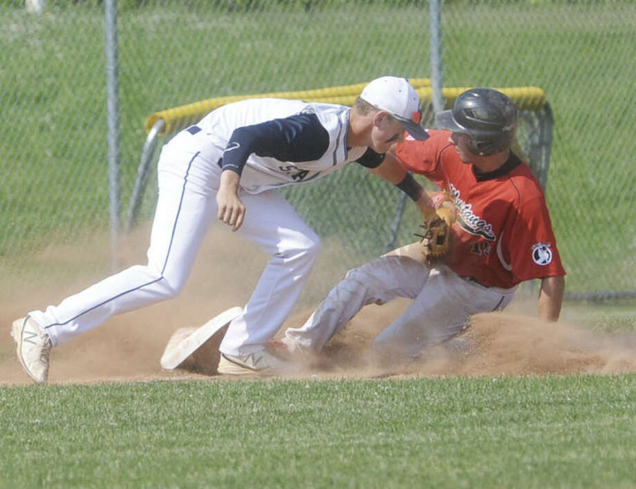 Hour photo/Matthew VinciStaples' Benjamin Casparius puts a tag at third on Nick Nardone of Fairfield Warde Tuesday. Nardone was safe and Warde would beat Staples.