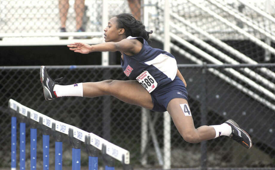 Hour photo/John NashSarah Boyd runs to the win in the 100-meter dash at Tuesday's Class LL state track championship meet.