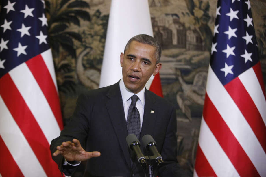 U.S. President Barack Obama answers a question during a joint news conference with Poland's President Bronislaw Komorowski at Belweder Palace in Warsaw, Poland, Tuesday, June 3, 2014. (AP Photo/Charles Dharapak)