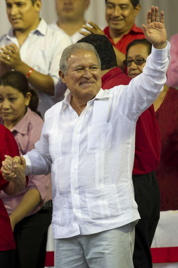 El Salvador's new President Salvador Sanchez Ceren, waves during a rally with supporters after his swearing-in ceremony in San Salvador, El Salvador, Sunday, June 1, 2014. (AP Photo/Moises Castillo)