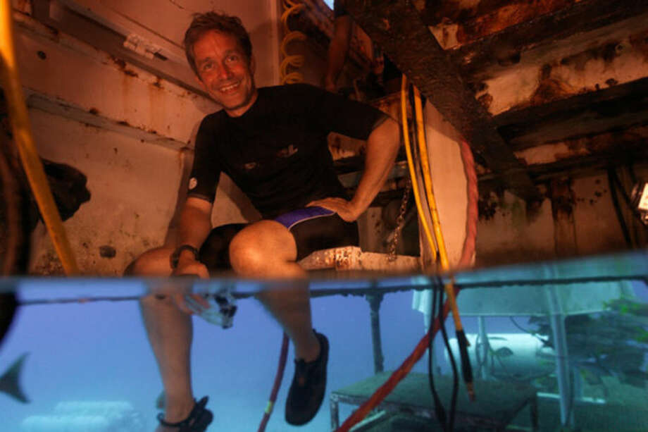 This 2012 photo provided by Mission 31, Fabien Cousteau sits inside Aquarius Reef Base in the Florida Keys National Marine Sanctuary. Beginning Sunday, June 1, 2014, the filmmaker and Jacques Cousteau's grandson plans to spend 31 days living underwater at the lab, making a documentary and leading a five-person crew on science experiments. (AP Photo/Courtesy of Mission 31)