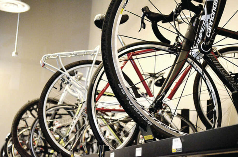 """Bikes sit on display in the employee """"bike lockerroom"""" at Cannondale Sports, located at i.Park on the Norwalk-Wilton line."""