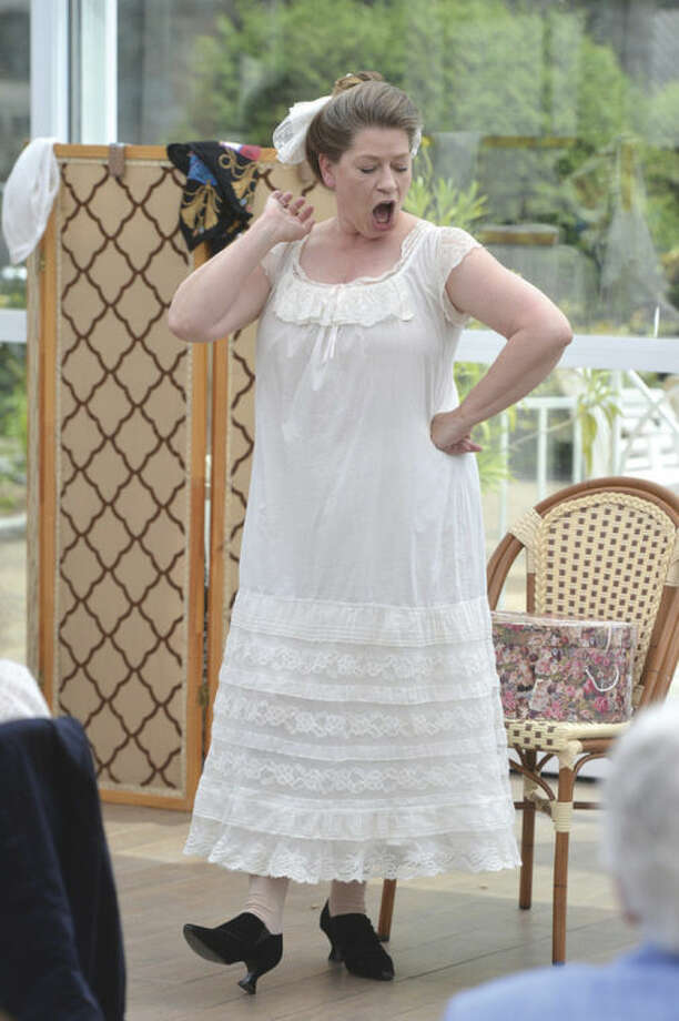 Hour Photo/Alex von Kleydorff The Norwalk Garden Club's 90 year anniversary high tea at The Norwalk Inn with entertainment from actress Kandie Carle who shows off some lingerie from the early 20's