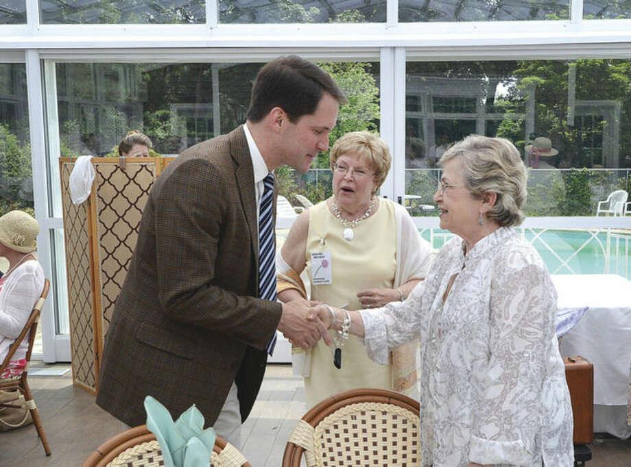 Hour Photo/Alex von Kleydorff President Janet Valus meets Congressman Jim Himes during the Norwalk Garden Club's 90 year anniversary high tea at The Norwalk Inn