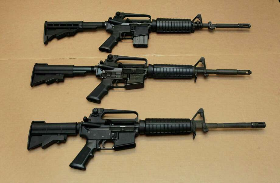 Three variations of the AR-15 assault rifle are displayed at the California Department of Justice in Sacramento, Calif. While the guns look similar, the bottom version is illegal in California because of its quick reload capabilities. Omar Mateen used an AR-15 that he purchased legally when he killed 49 people in an Orlando nightclub early Sunday.  President Barack Obama and other gun control advocates have repeatedly called for reinstating a federal ban on semi-automatic assault weapons that expired in 2004, but have been thwarted by Republicans in Congress. (AP file photo) Photo: Rich Pedroncelli, STF / Copyright 2016 The Associated Press. All rights reserved. This material may not be published, broadcast, rewritten or redistribu