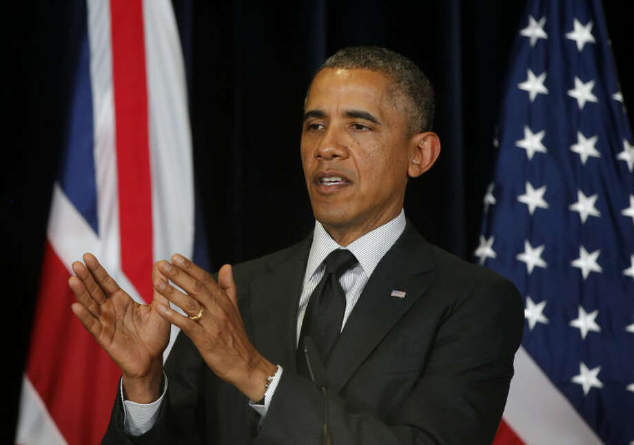 President Barack Obama speaks during a joint news conference with British Prime Minister David Cameron at the G7 summit in Brussels, Belgium, Thursday, June 5, 2014. (AP Photo/Charles Dharapak)