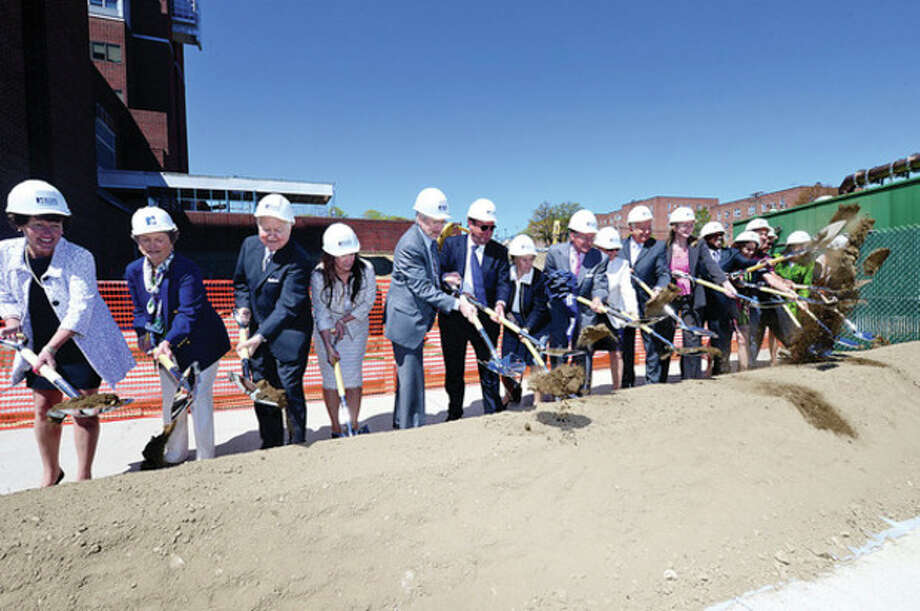 Donors, dignitaries and staff throw shovels of dirt as Norwalk Hospital holds a groundbreaking ceremony for new ambulatory care pavilion Friday.Hour photo / Erik Trautmann / (C)2013, The Hour Newspapers, all rights reserved
