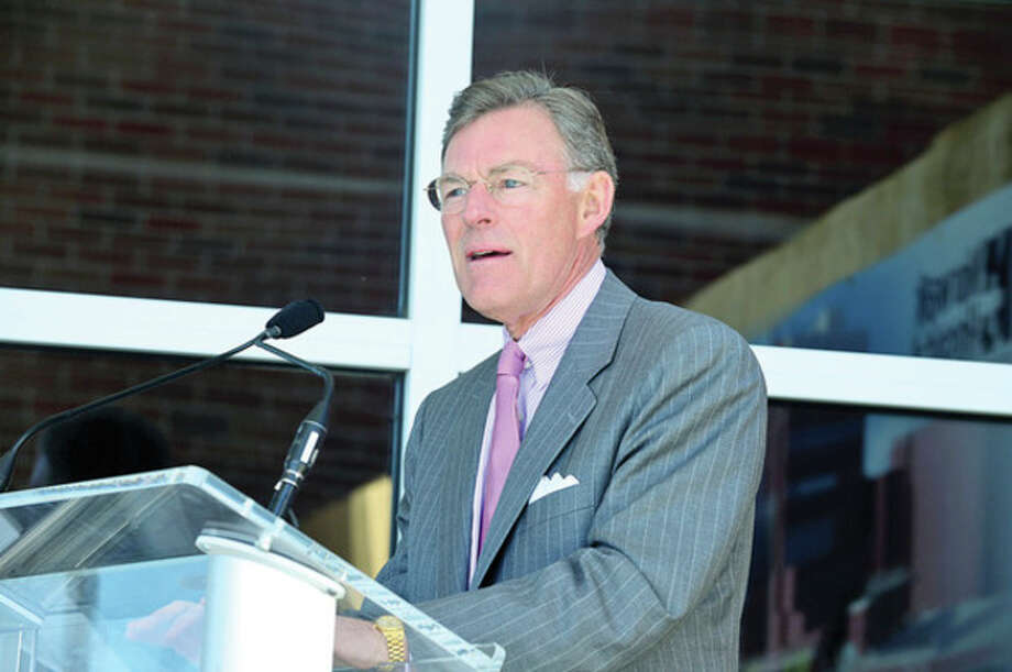 Terry McGraw speaks of his family's work with Norwalk Hospital as the hospital holds a groundbreaking ceremony for new ambulatory care pavilion Friday.Hour photo / Erik Trautmann / (C)2013, The Hour Newspapers, all rights reserved