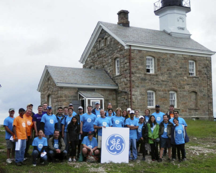 Contributed photoEmployees at GE Capital Real Estate volunteered to spruce up and repair Sheffield Island last weekend.