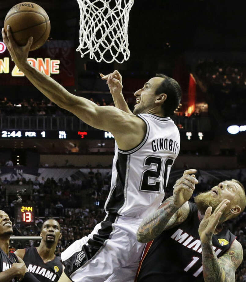 San Antonio Spurs guard Manu Ginobili (20) shoots over Miami Heat forward Chris Andersen during the first half in Game 2 of the NBA basketball finals on Sunday, June 8, 2014, in San Antonio. (AP Photo/Eric Gay)