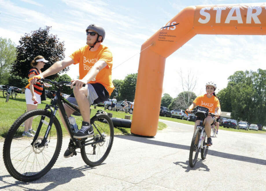 Hour photo / Matthew VinciDave Baklik and Maria Shahen come across the finish line at Sherwood Island Park in Westport for the 2014 MS Bike Ride, Dave's mother has had multiple sclerosis for 8 years.