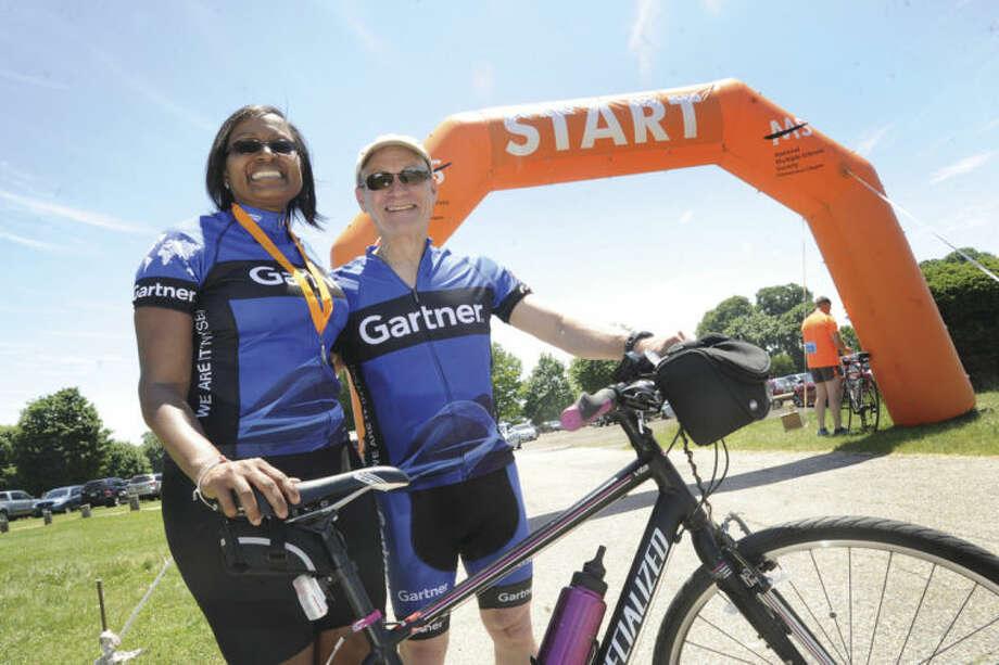 Celeste Weekes and Lew Schwartz who work at Gartner, Inc. in Stamford are bike riders in the 2014 MS Bike Ride Sunday at Sherwood Island Park in Westport on Sunday. Hour photo/Matthew Vinci