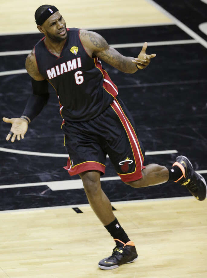 Miami Heat forward LeBron James (6) appeals to an official during the first half in Game 2 of the NBA basketball finals against the San Antonio Spurs on Sunday, June 8, 2014, in San Antonio. (AP Photo/Tony Gutierrez)