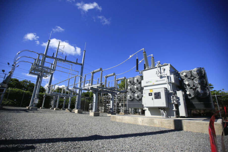 Hour Photo / Chris Palermo. The Third Taxing District Electric Department's Fitch Street substation is shown here during the dedication ceremony held for the newly opened substation Friday morning.