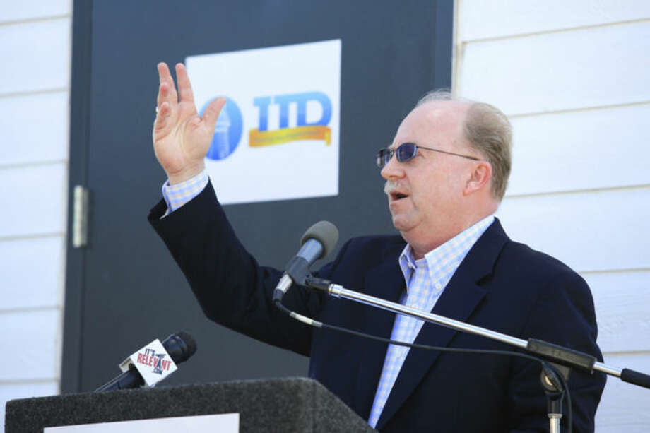 Hour Photo / Chris Palermo. Third Taxing District General Manager Jim Smith speaks during the Third Taxing District's Fitch Street substation dedication Friday morning.