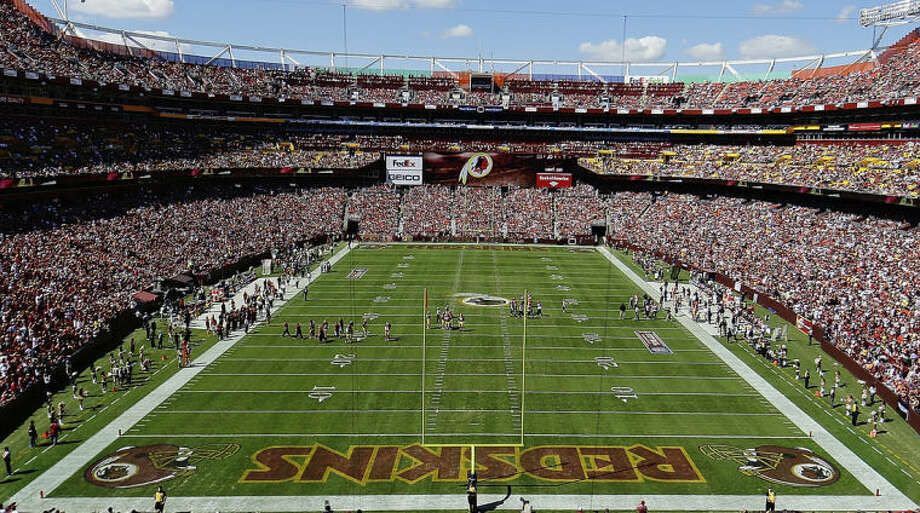 FILE - In this Sept. 24, 2012, file photo, the Washington Redskins and Cincinnati Bengals face off during the first half of an NFL football game in Landover, Md. The U.S. Patent Office ruled Wednesday, June 18, 2014, that the Washington Redskins nickname is