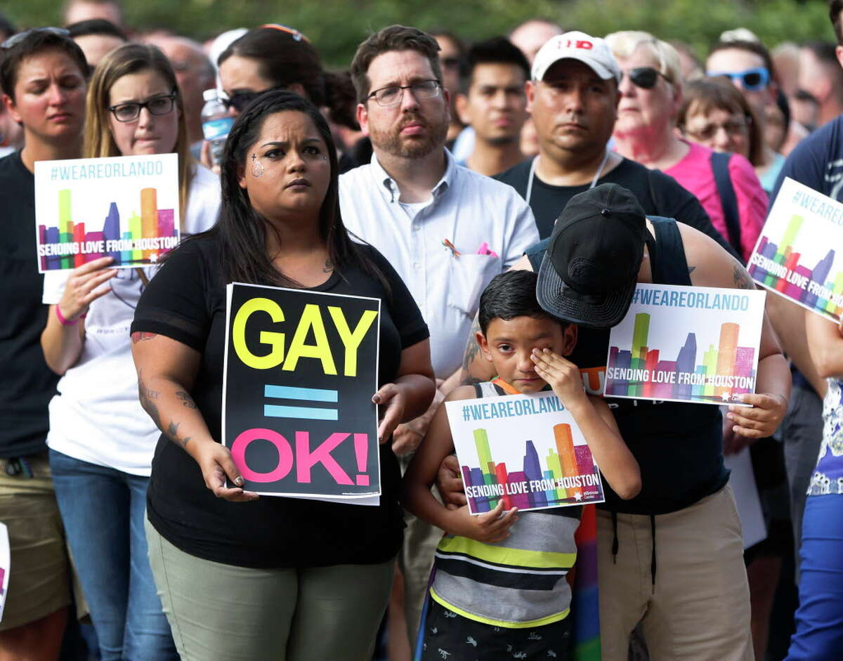 Tabitha Perez comforts David Castro, 8, as he wept during a vigil at The Montrose Center, for victims of the Orlando mass shooting event, Monday, June 13, 2016, in Houston.