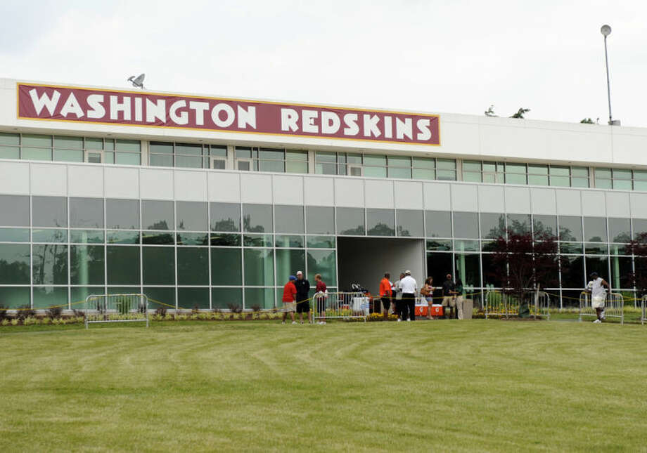 The Washington Redskins name is displayed on a building at their training facility at Redskins Park during NFL football minicamp, Wednesday, June 18, 2014, in Ashburn, Va. The U.S. Patent Office ruled Wednesday, June 18, 2014, that the Washington Redskins nickname is