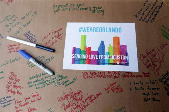People signed a poster showing support for Orlando during a vigil at The Montrose Center, for victims of the Orlando mass shooting event, Monday, June 13, 2016, in Houston.