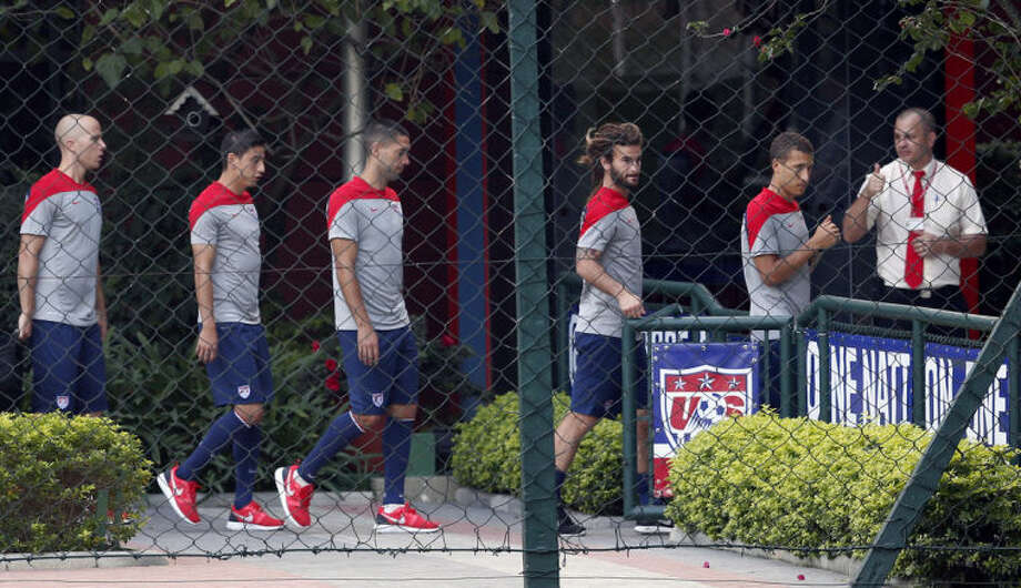 United States players walk toward an indoor workout during a training session in Sao Paulo, Brazil, Tuesday, June 17, 2014. The United States will play against Portugal in group G of the 2014 soccer World Cup on June 22. (AP Photo/Julio Cortez)