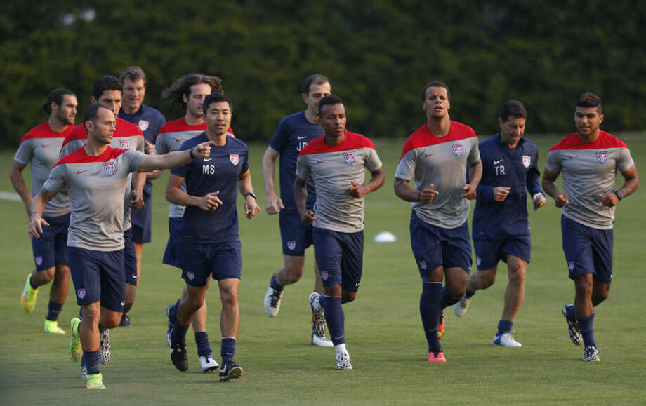 United States players warm up during a training session in Sao Paulo, Brazil, Tuesday, June 17, 2014. The United States will play against Portugal in group G of the 2014 soccer World Cup on June 22. (AP Photo/Julio Cortez)
