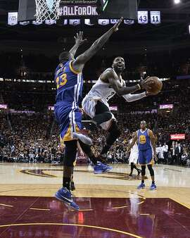 Cleveland Cavaliers guard Kyrie Irving (2) drives on Golden State Warriors forward Draymond Green (23) during the second half of Game 4 of basketball's NBA Finals in Cleveland, Friday, June 10, 2016. Golden State won 108-97. (Larry W. Smith/Pool Photo via AP)