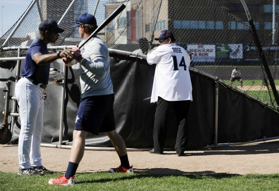 Pete Rose, right, looks over at manager Willie Upshaw, left, during batting practice at The Ballpark at Harbor Yard, Monday, June 16, 2014, in Bridgeport, Conn. Rose, banned from Major League Baseball, returned to the dugout for one day to manage the independent minor-league Bridgeport Bluefish. (AP Photo/Jessica Hill)