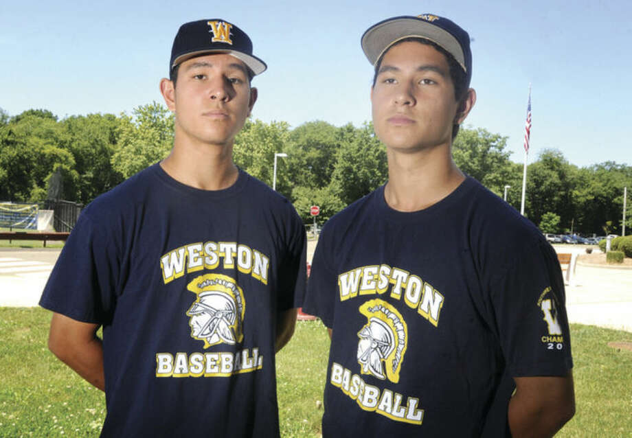 Hour photo/Matthew VinciAsher, left, and Ethan Lee-Tyson, twins and star athletes at Weston High School.