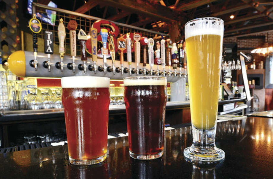 Hour photo / Erik TrautmannSmuttynose Old Brown Dog Ale, Six Point Sweet Action and SBC Hydroponic American White Ale are just three of 24 drafts available during happy hour.