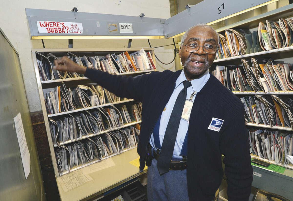 Hour Photo/Alex von Kleydorff Ernest Ramsey points to a sticker ' Where's Bubba