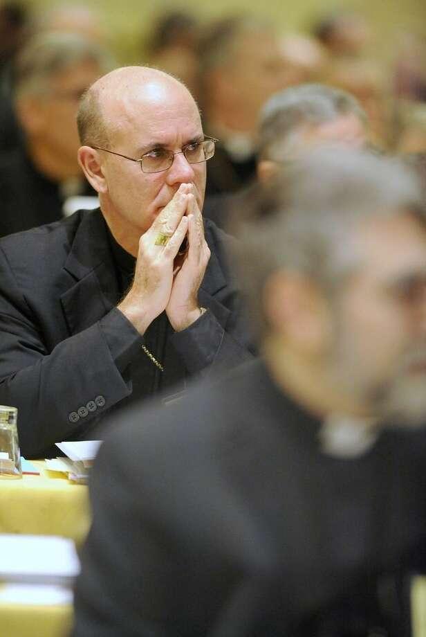 Bishop Kevin C. Rhoades of Fort Wayne-South Bend, Ind., attends the U.S. Conference of Catholic Bishops general meeting in Baltimore Monday, Nov. 10, 2014. (AP Photo/Steve Ruark)