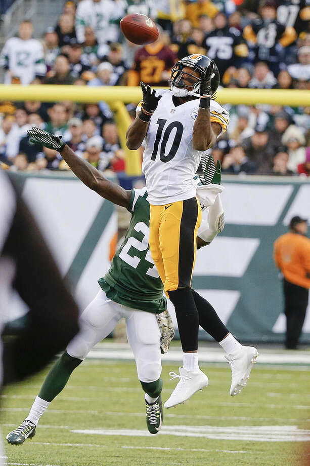 Pittsburgh Steelers wide receiver Martavis Bryant (10) catches a pass in front of New York Jets' Phillip Adams (24) during the second half of an NFL football game Sunday, Nov. 9, 2014, in East Rutherford, N.J. (AP Photo/Kathy Willens)