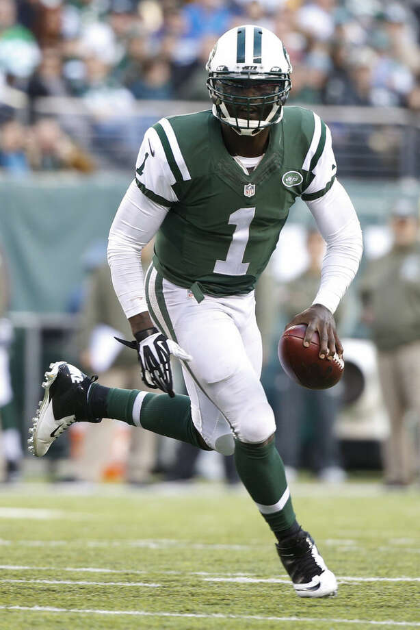 New York Jets quarterback Michael Vick (1) scrambles during the second half of an NFL football game against the Pittsburgh Steelers, Sunday, Nov. 9, 2014, in East Rutherford, N.J. (AP Photo/Kathy Willens)