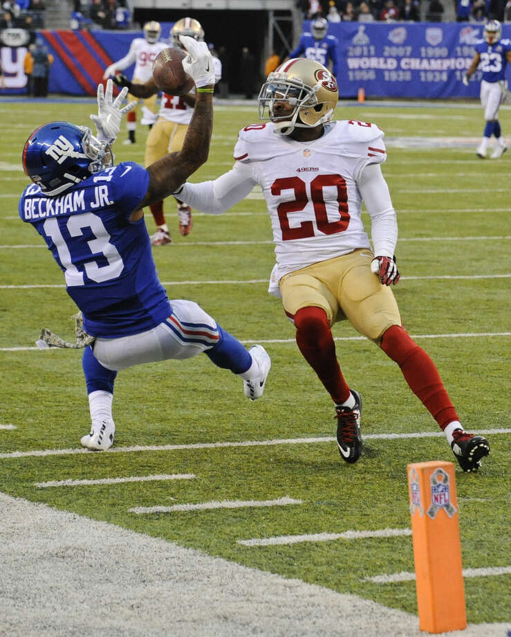 New York Giants wide receiver Odell Beckham (13) catches a pass in front of San Francisco 49ers' Perrish Cox (20) during the second half of an NFL football game Sunday, Nov. 16, 2014, in East Rutherford, N.J. The 49ers won the game 16-10. (AP Photo/Bill Kostroun)