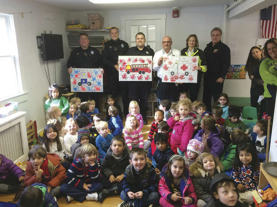 Three, Four Open the Door Preschool students and teachers honor Westports' Emergency Services at the Westport preschool Friday.