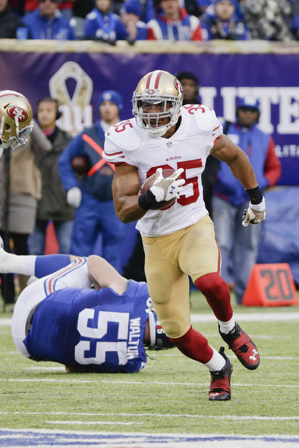 San Francisco 49ers free safety Eric Reid (35) runs back an interception during the second half of an NFL football game against the New York Giants Sunday, Nov. 16, 2014, in East Rutherford, N.J. (AP Photo/Julio Cortez)