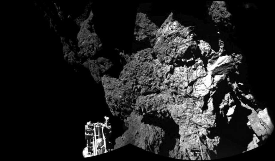 The combination photo of different images taken with the CIVA camera system released by the European Space Agency ESA on Thursday Nov. 13, 2014 shows Rosetta's lander Philae as it is safely on the surface of Comet 67P/Churyumov-Gerasimenko, as these first CIVA images confirm. One of the lander's three feet can be seen in the foreground. hilae became the first spacecraft to land on a comet when it touched down Wednesday on the comet, 67P/Churyumov-Gerasimenko. (AP Photo/Esa/Rosetta/Philae)