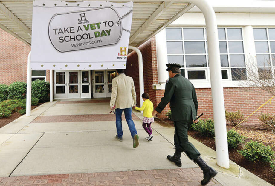 Hour photo / Erik Trautmann Cider Mill Elementary School implemented the History Channel's Take a Veteran to School Day as part of their recognition of Veteran's Day in Wilton Tuesday.