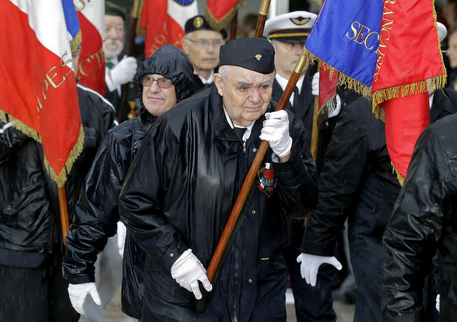 Veterans take part in an Armistice Day ceremony, in Nice, southern France, Tuesday, Nov. 11, 2014. Armistice Day is commemorated every year on Nov. 11 to mark the armistice signed between the allies of World War I and Germany to end the war. (AP Photo/Lionel Cironneau)