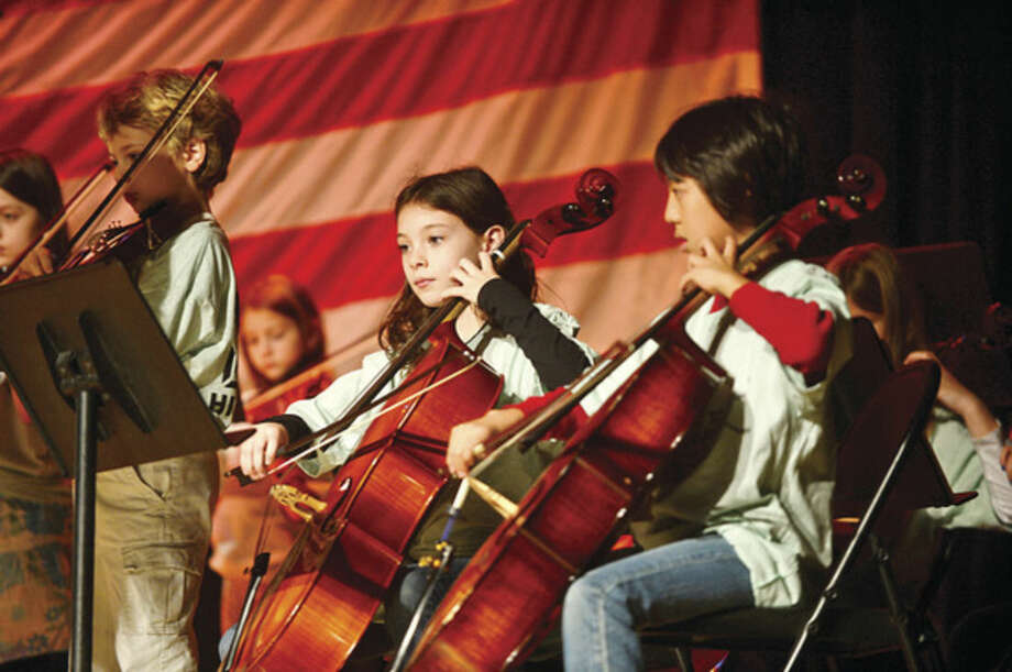 "Hour photo / Erik Trautmann Cider Mill 5th grader Natlaie Sexton plays ""America the Beautiful"" with the 5th grade orchestra during a Veteran's Day assembly at Cider Mill Elementary School in Wilton Tuesday."