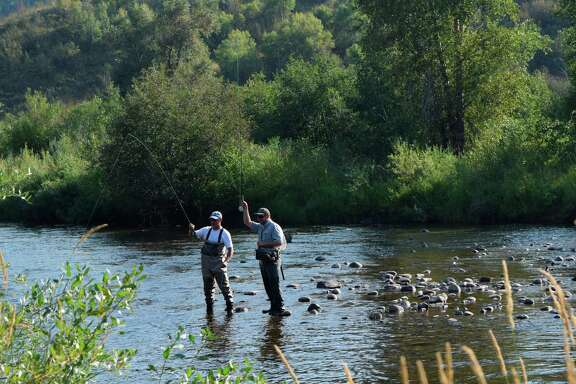 Fly fishing can be found on the Yampa River in the summer near downtown Steamboat Springs, Colo.