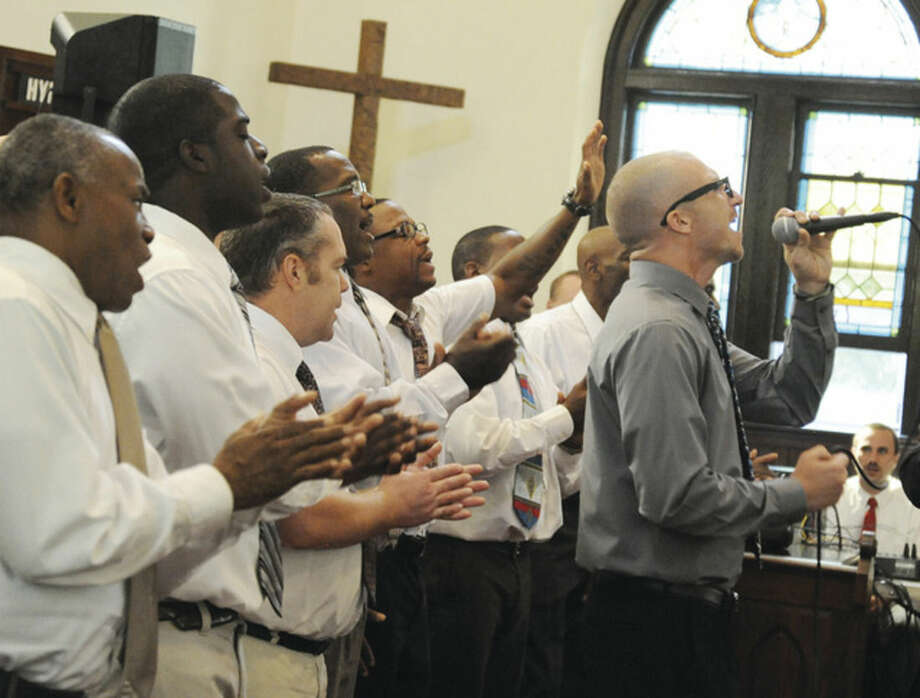 Hour photo/Matthew VinciThe Pivot Ministries Rehab Choir performs Sunday at Norwalk's Calvin Reformed Church.