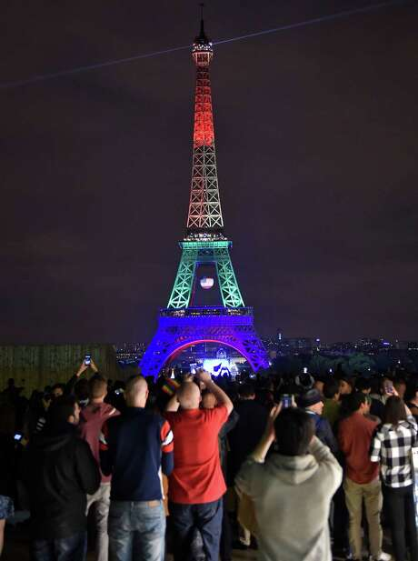 The Eiffel Tower in Paris is ablaze with the colors of a rainbow on Monday to honor victims of Sunday's mass shooting at an Orlando, Fla., gay nightclub.  Photo: Martin Meissner, STR / Copyright 2016 The Associated Press. All rights reserved. This material may not be published, broadcast, rewritten or redistribu