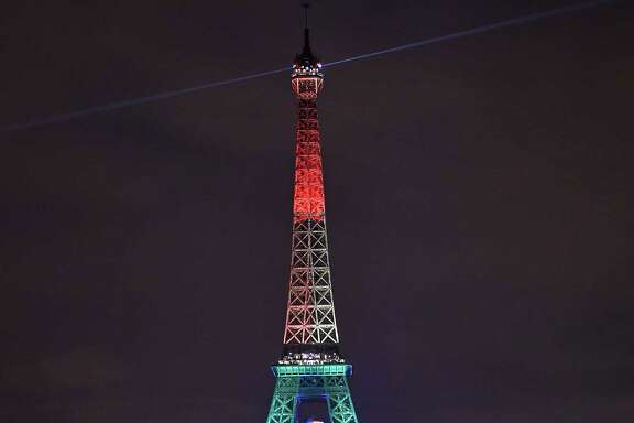 The Eiffel Tower in Paris is ablaze with the colors of a rainbow on Monday to honor victims of Sunday's mass shooting at an Orlando, Fla., gay nightclub.