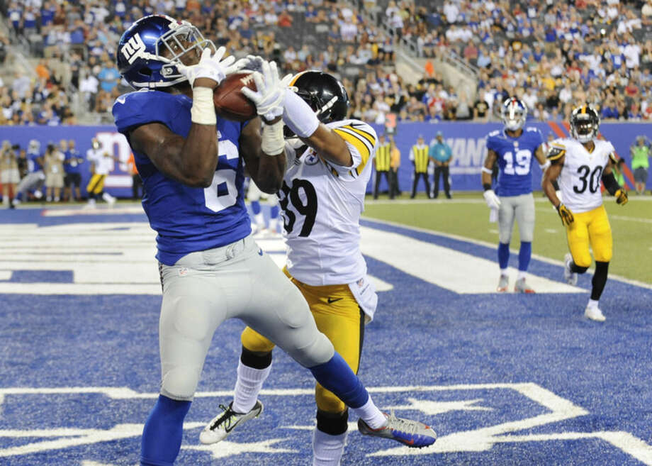 New York Giants wide receiver Corey Washington (6) makes a catch for a touchdown against Pittsburgh Steelers defensive back Isaiah Green (39) in the fourth quarter of a preseason NFL football game, Saturday, Aug. 9, 2014, in East Rutherford, N.J. (AP Photo/Bill Kostroun)