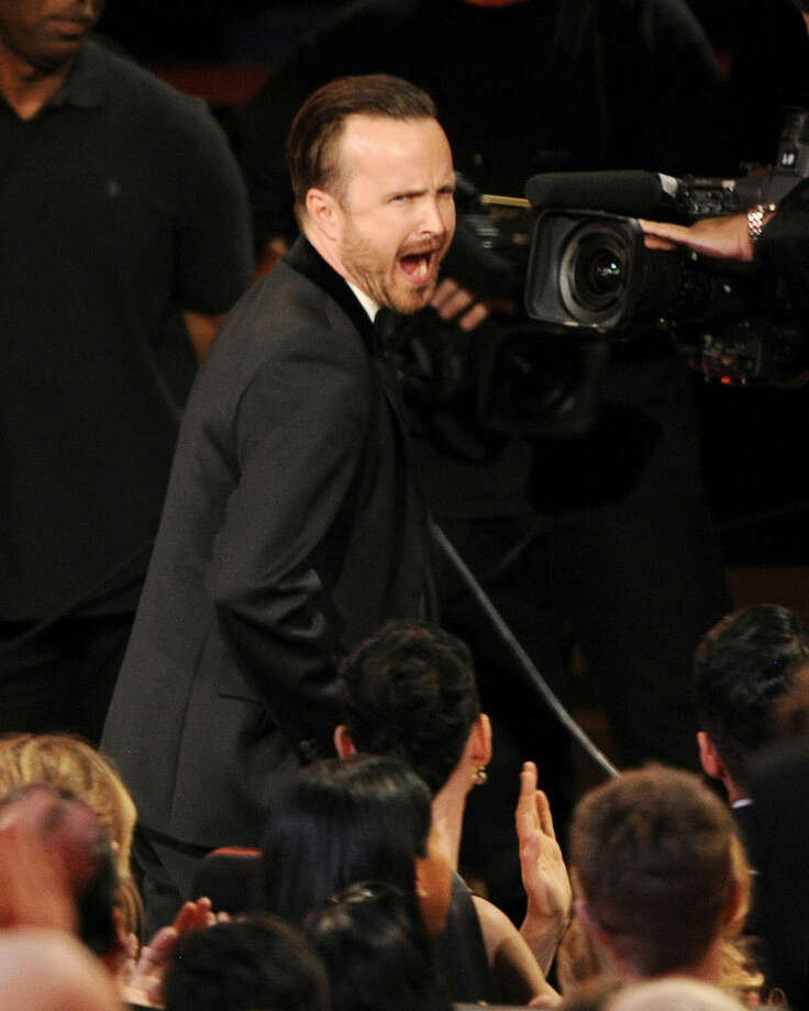"Aaron Paul walks to the stage to accept the award for outstanding supporting actor in a drama series for his work on ""Breaking Bad"" at the 66th Annual Primetime Emmy Awards at the Nokia Theatre L.A. Live on Monday, Aug. 25, 2014, in Los Angeles. (Photo by Chris Pizzello/Invision/AP)"