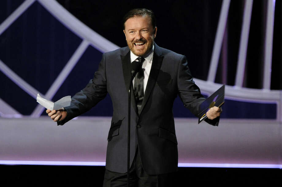 Ricky Gervais presents the award for outstanding writing for a variety, music or comedy special on stage at the 66th Annual Primetime Emmy Awards at the Nokia Theatre L.A. Live on Monday, Aug. 25, 2014, in Los Angeles. (Photo by Chris Pizzello/Invision/AP)