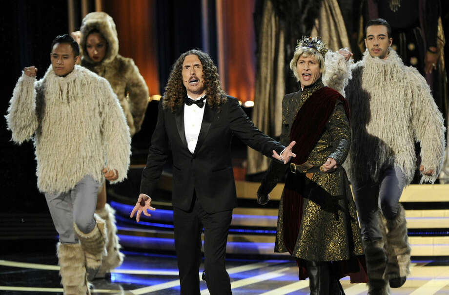 Weird Al Yankovic, left, and Andy Samberg perform on stage at the 66th Annual Primetime Emmy Awards at the Nokia Theatre L.A. Live on Monday, Aug. 25, 2014, in Los Angeles. (Photo by Chris Pizzello/Invision/AP)
