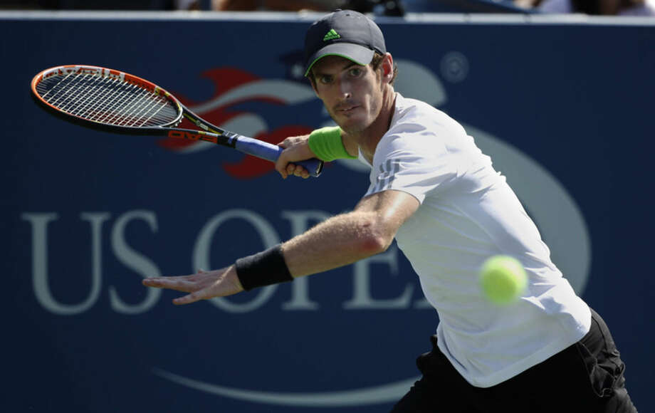 Andy Murray, of the United Kingdom, returns a shot against Robin Haase, of the Netherlands, during the opening round of the 2014 U.S. Open tennis tournament, Monday, Aug. 25, 2014, in New York. (AP Photo/Kathy Willens)