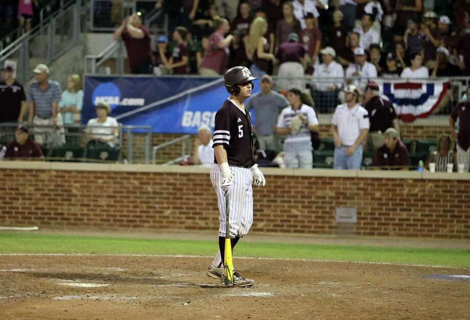 Michael Barash's body language said it all after he struck out looking in the ninth inning Sunday night, ending Texas A&M's season after a 4-1 loss to TCU. Photo: Sam Craft, FRE / AP